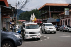 Downtown Boquete. If you look closely at the white van you can see the names Boquete and Palmira, which are the 2 towns the van services.