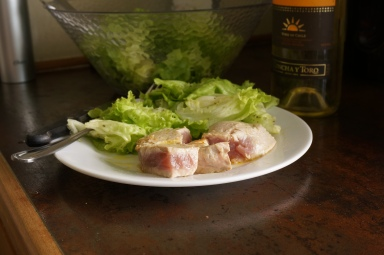Seared tuna and a salad with a glass of wine...YUM! All for about $4.