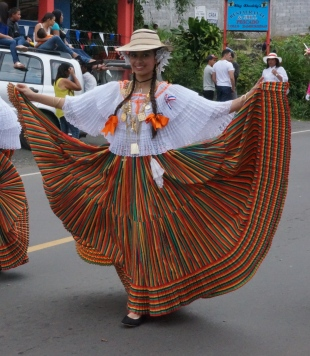 The traditional dress has full skirts and are carried like this...