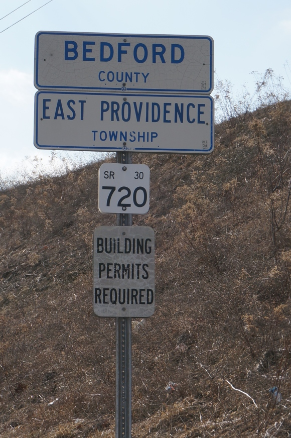 Not sure why it's posted on a road sign that a building permit is required in this township