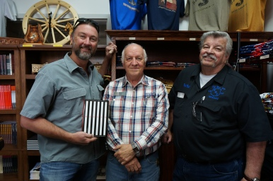 "Guy holding ""Warden"" book, Jim Willett, the author & Ray."