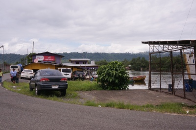 Picture of the water taxi building from where the bus parked. It has the large red Digicel sign on it.